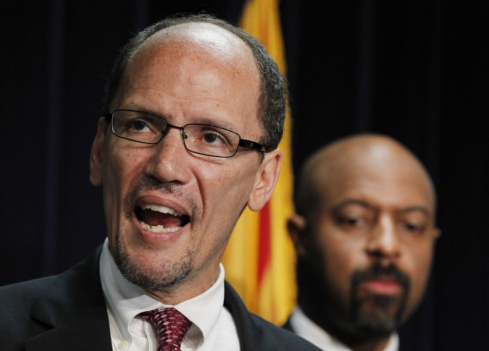 Photo -   United States Assistant Attorney General Thomas Perez, left, who heads up the civil rights division at the Department of Justice, is joined by Deputy Assistant Attorney General for Civil Rights, Roy Austin, as Perez announces a federal civil lawsuit against Maricopa County Sheriff Joe Arpaio during a news conference Thursday, May 10, 2012, in Phoenix. The move came after months of negotiations failed to yield an agreement to settle allegations that his department racially profiled Latinos in his trademark immigration patrols. (AP Photo/Ross D. Franklin)