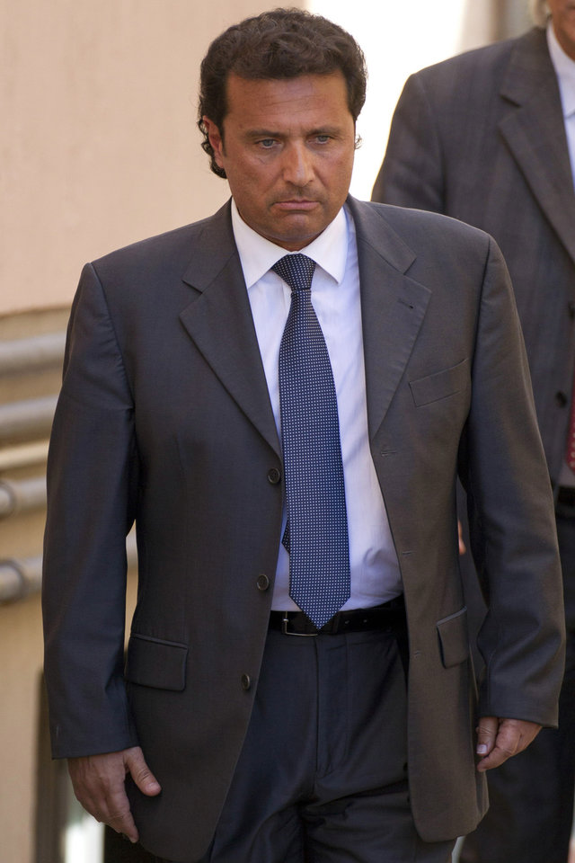 Photo - FILE -- In this file photo taken in Grosseto on April 15 2013, former captain of the Costa Concordia luxury cruise ship Francesco Schettino leaves after a closed-door hearing. The Italian captain of the Costa Concordia cruise ship was ordered on Wednesday to stand trial for manslaughter in the luxury liner's shipwreck off the coast of Tuscany, which killed 32 people. Judge Pietro Molino, at a closed door hearing in the town of Grosseto, agreed to prosecutors' requests that Francesco Schettino should be tried on charges of manslaughter, causing the shipwreck and abandoning the vessel while many of the 4,200 passengers and crew were still aboard. (AP Photo/Andrew Medichini)