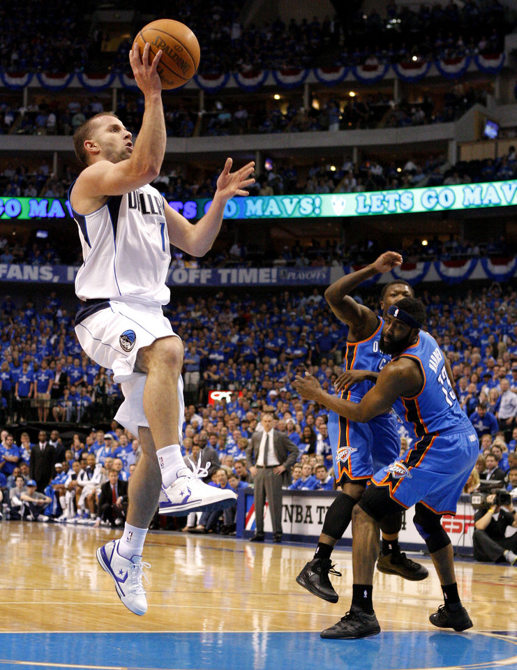 Jose Juan Barea (11) of Dallas goes past Oklahoma City's Nate Robinson (3) and James Harden (13) during game 1 of the Western Conference Finals in the NBA basketball playoffs between the Dallas Mavericks and the Oklahoma City Thunder at American Airlines Center in Dallas, Tuesday, May 17, 2011. Photo by Bryan Terry, The Oklahoman