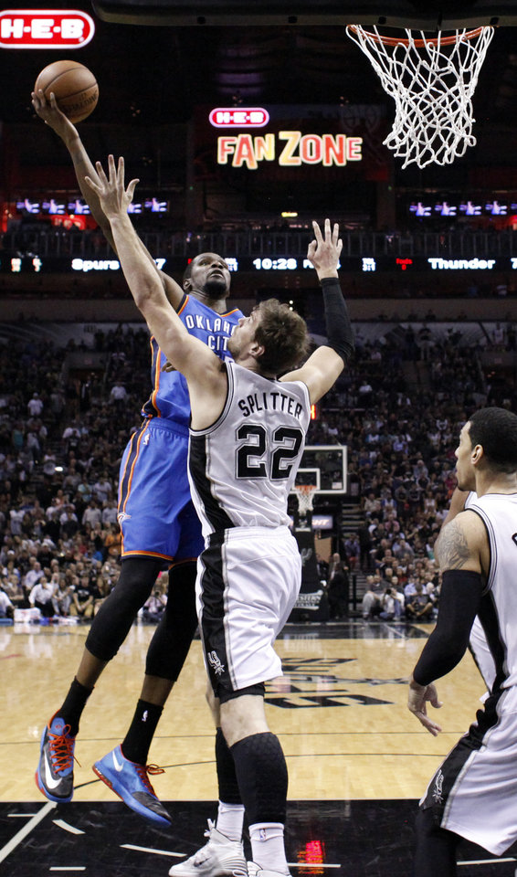 Photo - Oklahoma City's Kevin Durant (35) shoots as San Antonio's Tiago Splitter (22) defends during Game 5 of the Western Conference Finals in the NBA playoffs between the Oklahoma City Thunder and the San Antonio Spurs at the AT&T Center in San Antonio, Thursday, May 29, 2014. Photo by Sarah Phipps, The Oklahoman