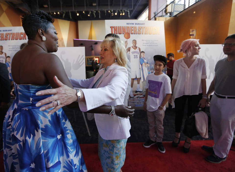 Wanda Pratt, mother of Kevin Durant, greets Oklahoma Gov. Mary Fallin during the red carpet premiere of Thunderstruck at Harkins Bricktown Theatre in Oklahoma City, Sunday, Aug. 19, 2012.  Photo by Garett Fisbeck, For The Oklahoman