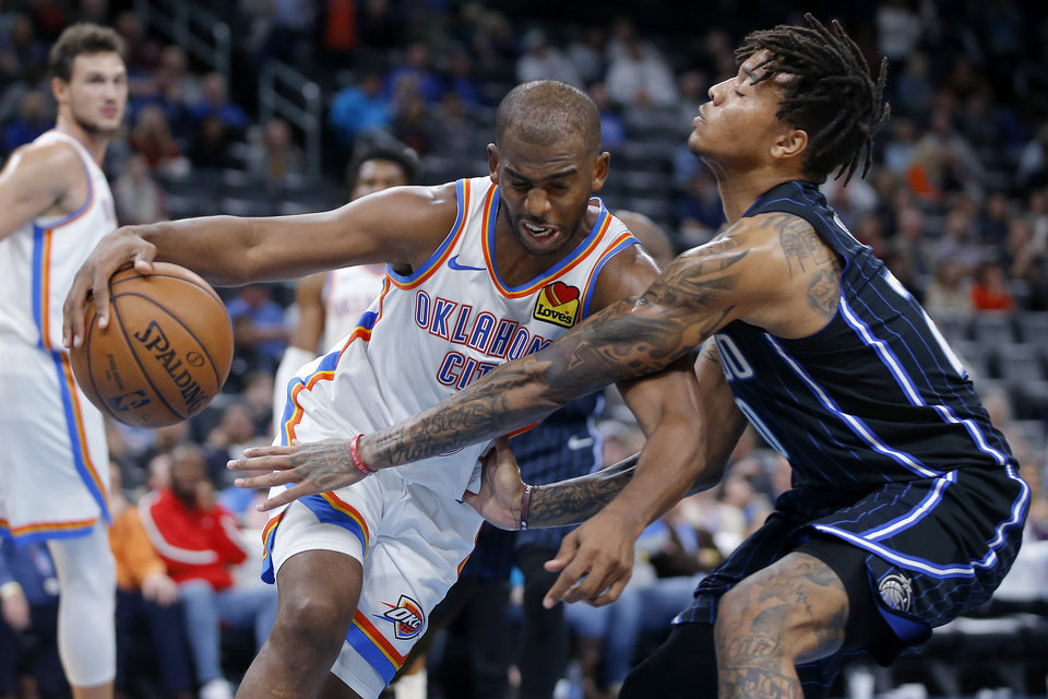 Photo - Oklahoma City's Chris Paul (3) is fouled by Orlando's Markelle Fultz (20) during an NBA basketball game between the Oklahoma City Thunder and the Orlando Magic at Chesapeake Energy Arena in Oklahoma City, Tuesday, Nov. 5, 2019. Oklahoma City won 102-94. [Bryan Terry/The Oklahoman]