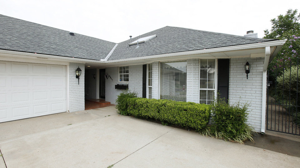 Photo - A Realtor recently handled the sale of this house on Dahoon Drive.  PAUL B. SOUTHERLAND - The Oklahoman