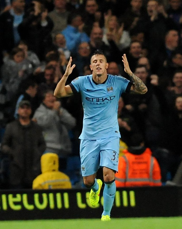 Photo - Manchester City's Stevan Jovetic reacts after scoring against Liverpool during the English Premier League soccer match between Manchester City and Liverpool at the Etihad Stadium, in Manchester, England, Monday, Aug. 25, 2014. (AP Photo/Rui Vieira)