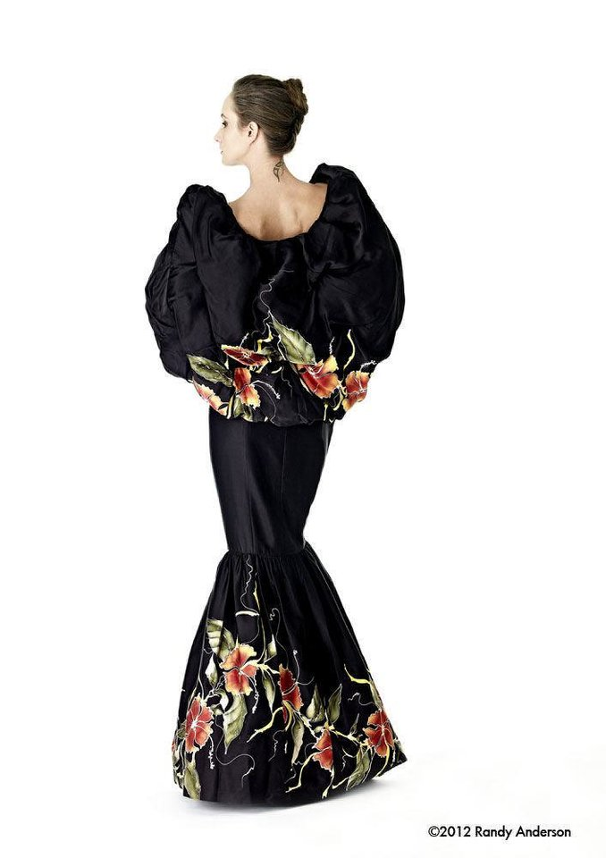 Photo - This black silk gown is handpainted with a floral pattern. The gown was Stella Thomas' entry which won the Asian Designer Awards in 2007. Photo by Randy Anderson.