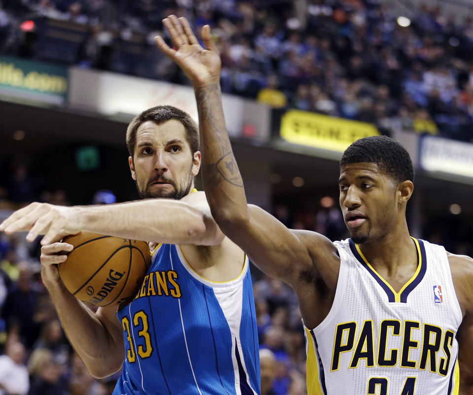 Photo -   New Orleans Hornets' Ryan Anderson (33) grabs a rebound from Indiana Pacers' Paul George during the second half of an NBA basketball game, Wednesday, Nov. 21, 2012, in Indianapolis. The Pacers won 115-107 in overtime. (AP Photo/Darron Cummings)