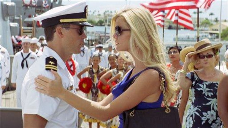 "In this film image released by Universal Pictures, actress Brooklyn Decker, right, is shown with Taylor Kitsch in a scene from ""Battleship."" A former swimsuit model, Decker is posing for the cameras more than ever.  But now she's exchanged bathing suits for premiere-worthy gowns while on tour promoting her two new films, ""Battleship,"" and ""What to Expect When You're Expecting."" (AP Photo/Universal  Pictures) HOLD FOR SAMANTHA CRITCHELL STORY MOVING FRIDAY - In this film image released by Universal Pictures, actress Brooklyn Decker, right, is shown with Taylor Kitsch in a scene from ""Battleship."" A former swimsuit model, Decker is posing for the cameras more than ever.  But now she's exchanged bathing suits for premiere-worthy gowns while on tour promoting her two new films, ""Battleship,"" and ""What to Expect When You're Expecting."" (AP Photo/Universal  Pictures)"