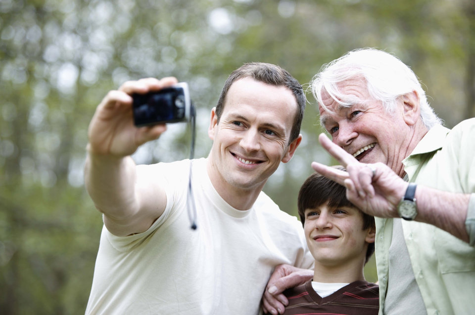 Man taking a picture of family