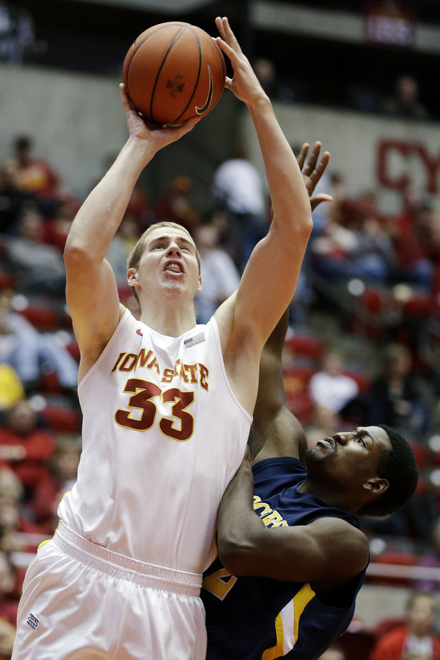 Photo -   Iowa State forward Tyler Ellerman (33) shoots over North Carolina A&T forward Corvon Butler during the second half of an NCAA college basketball game, Tuesday, Nov. 20, 2012, in Ames, Iowa. Iowa State won 86-57. (AP Photo/Charlie Neibergall)