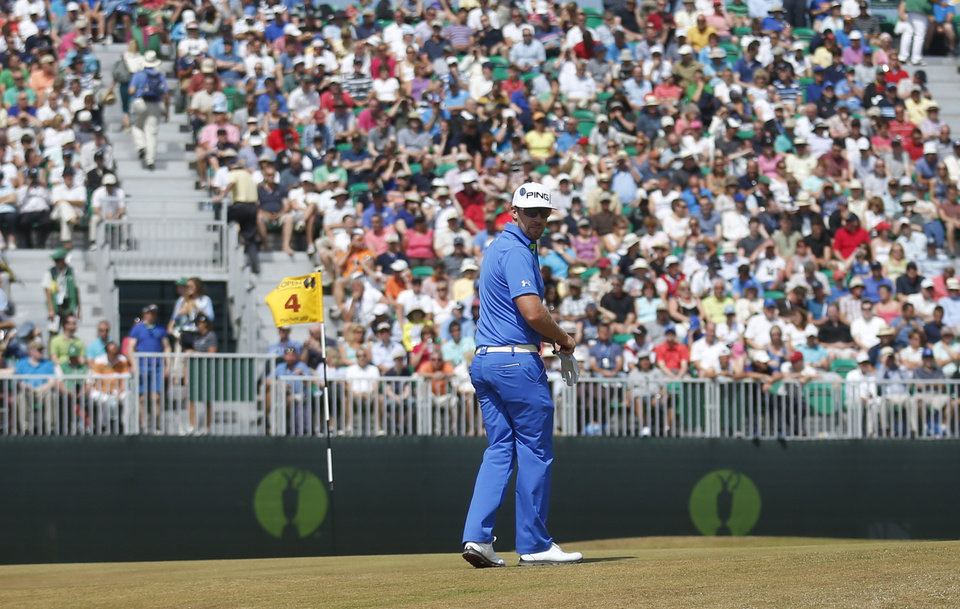 Hunter Mahan of the United States prepares to putt on the 4th green during the third round of the British Open Golf Championship at Muirfield, Scotland, Saturday July 20, 2013. (AP Photo/Peter Morrison)