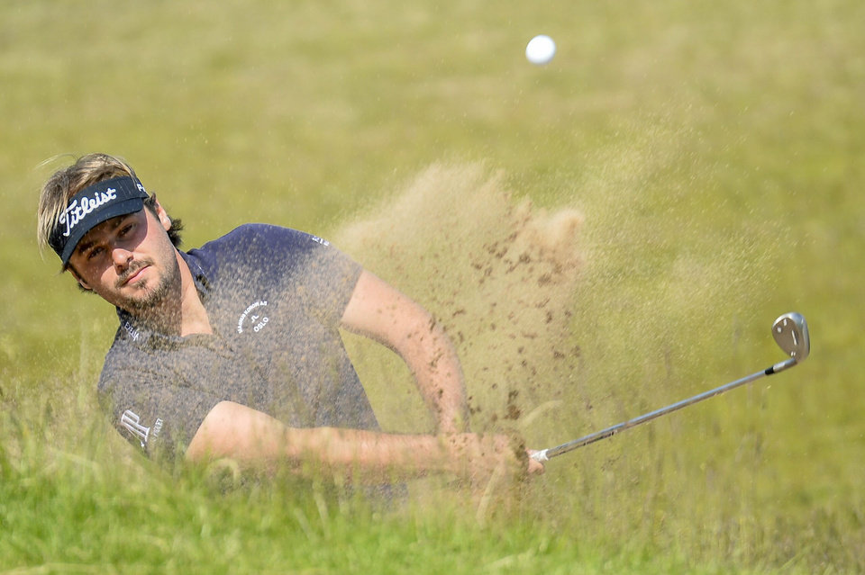 Photo - Victor Dubuisson of France hits out of a bunker on the 14th hole during the final round of the Nordea Masters at PGA National, in Malmo, southern Sweden, Sunday, June 1, 2014. (AP Photo/TT, Anders Wiklund) SWEDEN OUT