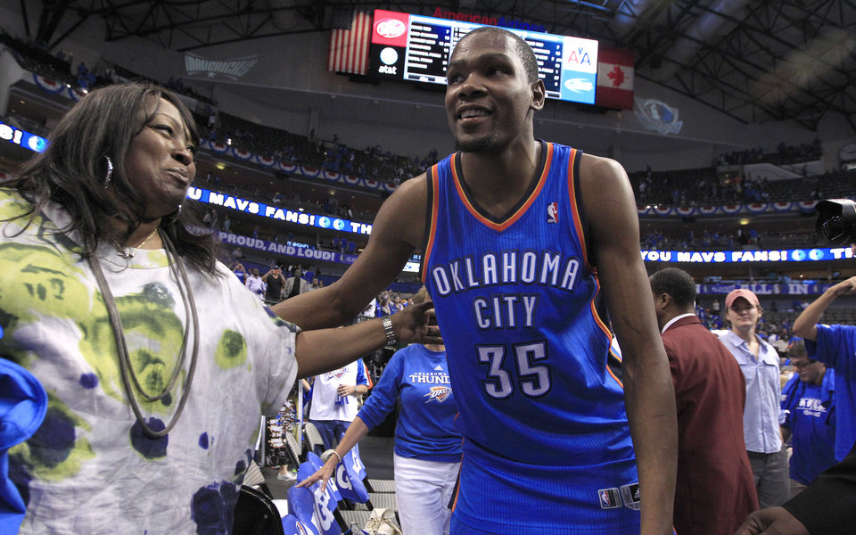 Photo -   Oklahoma City Thunder Kevin Durant (35) greets teammate James Harden's mother Monja Willis after the 103-97 win against the Dallas Mavericks in Game 4 of a first-round NBA basketball playoff series, Saturday, May 5, 2012, in Dallas. (AP Photo/LM Otero)
