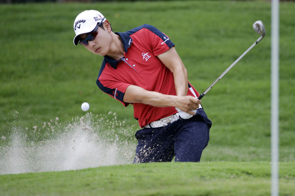 Photo - Sang-Moon Bae, of South Korea, chips onto the 17th green during the first round of the St. Jude Classic golf tournament Thursday, June 5, 2014, in Memphis, Tenn. Bae took a par on the hole. (AP Photo/Mark Humphrey)