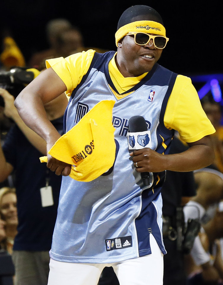 "Rapper Al Kapone leads the crowd in chanting ""Whoop That Trick"" during Game 3 in the second round of the NBA basketball playoffs between the Oklahoma City Thunder and Memphis Grizzles at the FedExForum in Memphis, Tenn., Saturday, May 11, 2013. Memphis won, 87-81. Photo by Nate Billings, The Oklahoman"