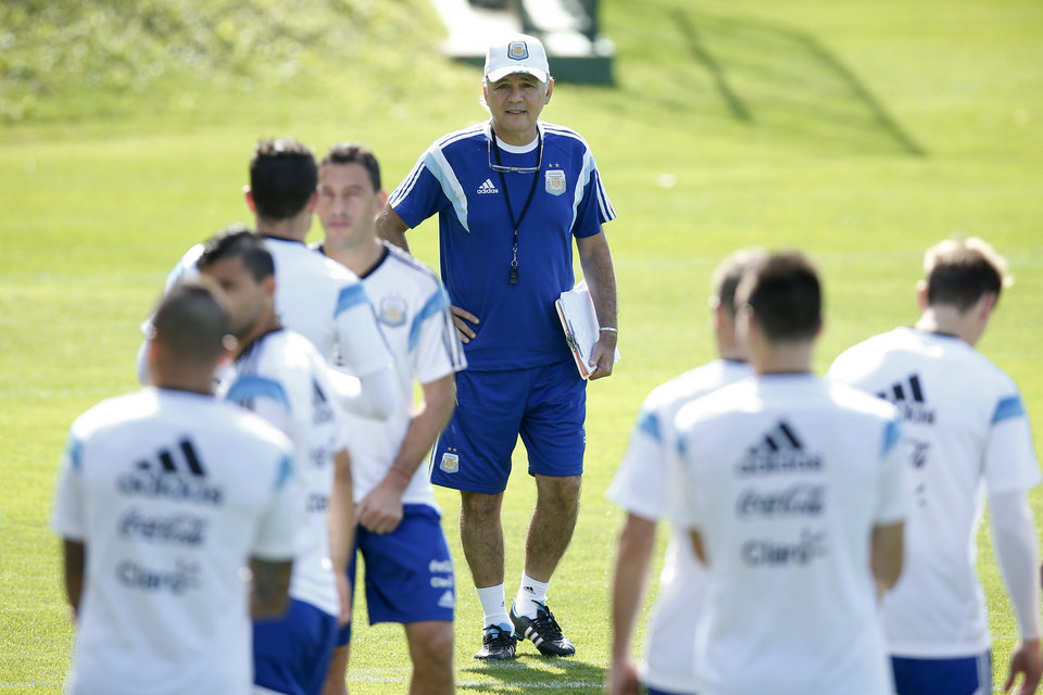Photo - Argentina's head coach Alejandro Sabella, center, looks at his players during a training session in Vespasiano, near Belo Horizonte, Brazil, Friday, June 20, 2014.  Argentina plays in group F of the 2014 soccer World Cup. (AP Photo/Victor R. Caivano)