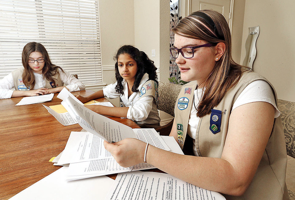 Photo - Melanie Michaud, Tanvi Saran and Kaete-Marie Legler, all 13, work on their Silver Award Girl Scout project Friday in Norman.  Photo by Steve Sisney, The Oklahoman  STEVE SISNEY - THE OKLAHOMAN