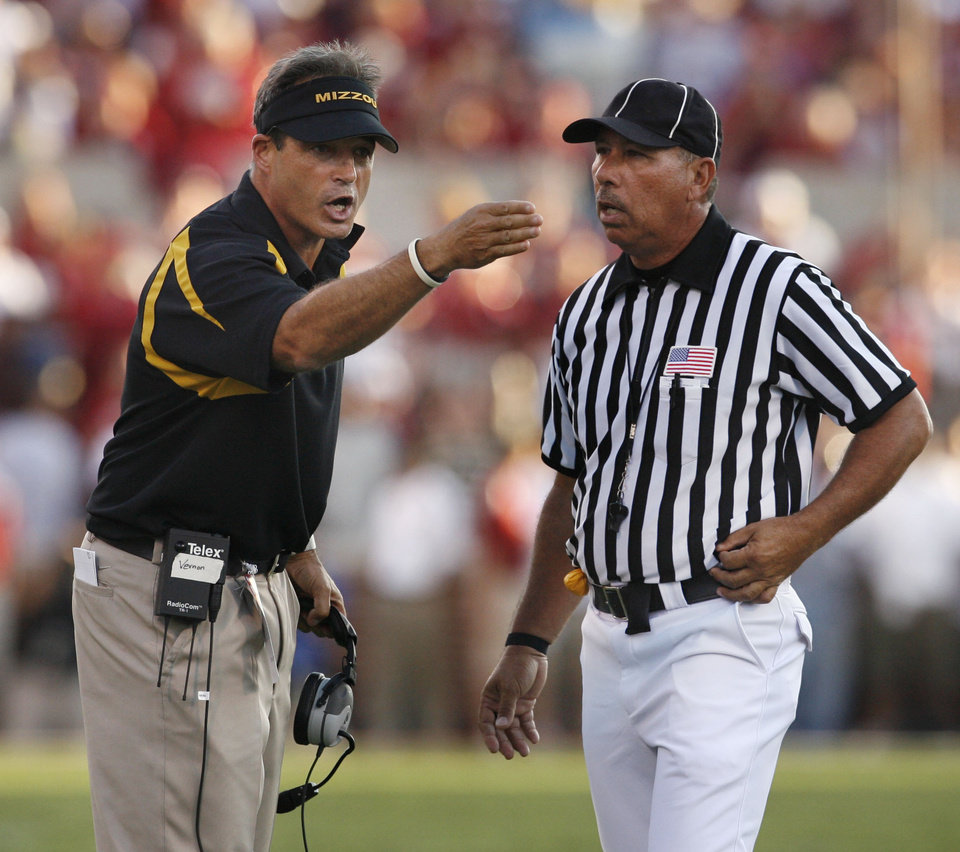 Photo - Missouri head coach Gary Pinkel argues with a Chris Brown touchdown call and prevails during the first half of the college football game between the University of Oklahoma Sooners (OU) and the University of Missouri Tigers (MU) at the Gaylord Family Oklahoma Memorial Stadium on Saturday, Oct. 13, 2007, in Norman, Okla.  By STEVE SISNEY, The Oklahoman