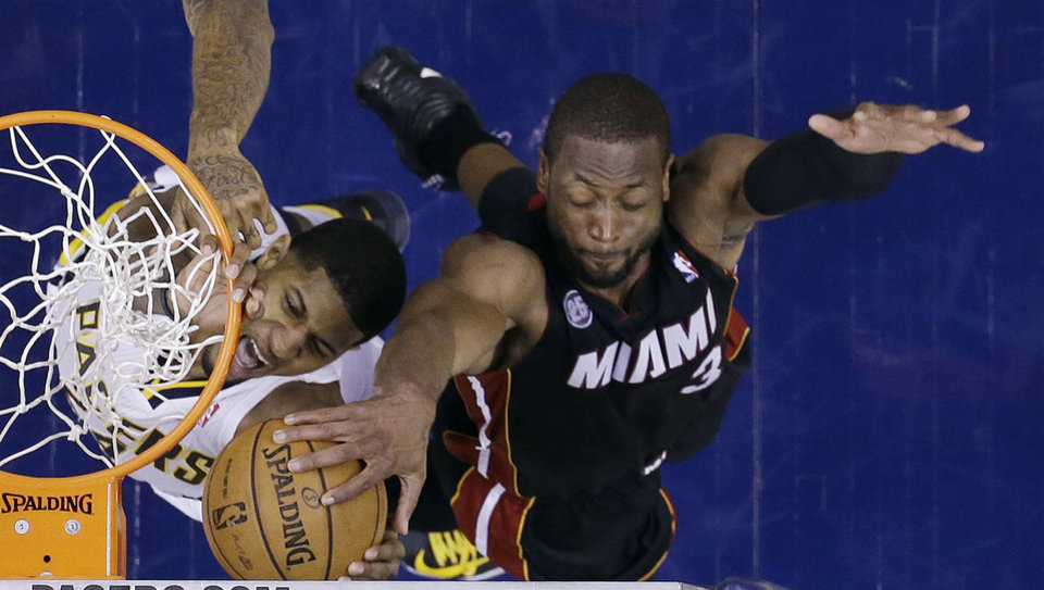 Indiana Pacers' Paul George has his shot blocked by Miami Heat's Dwyane Wade (3) during the second half of Game 3 of the NBA Eastern Conference basketball finals in Indianapolis, Sunday, May 26, 2013. (AP Photo/Michael Conroy)