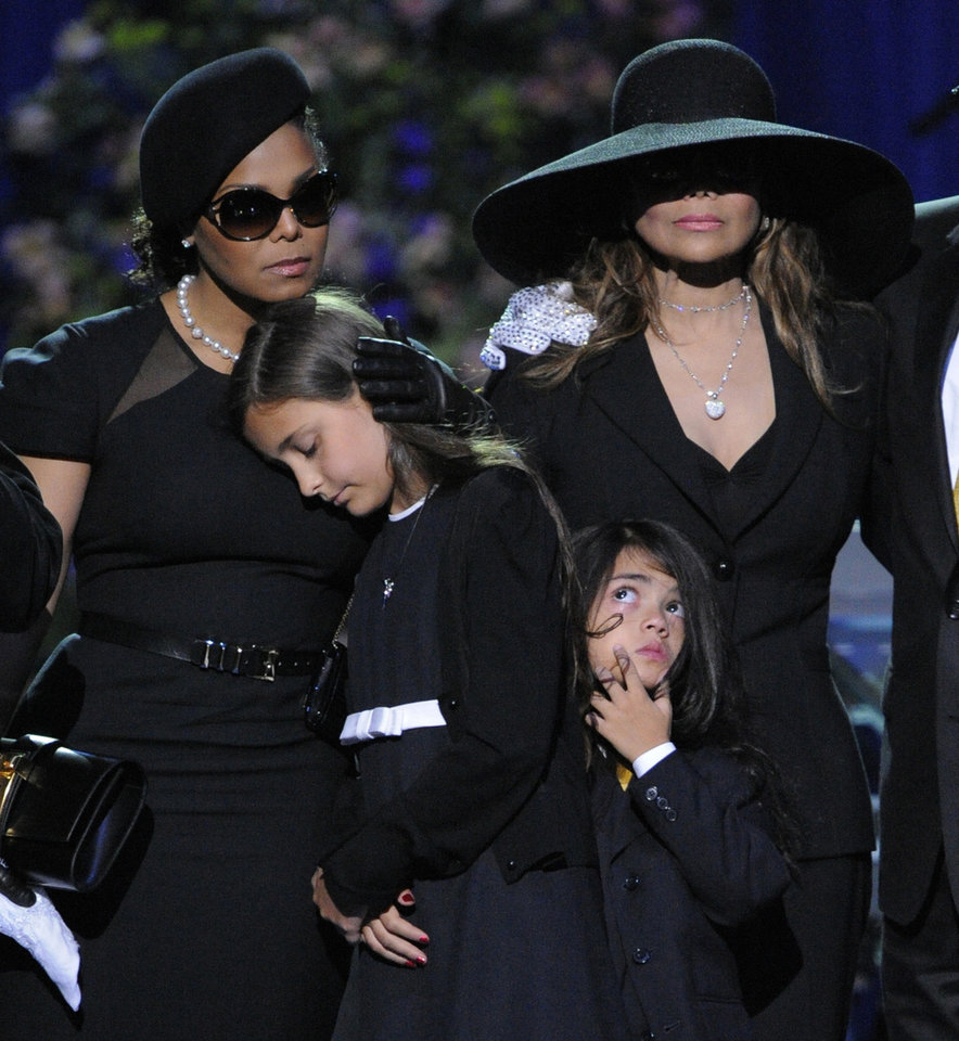 FILE - This July 7, 2009 file photo shows singer Janet Jackson, left, Paris Katherine Jackson, Prince Michael Jackson II, and LaToya Jackson on stage during the memorial service for Michael Jackson at the Staples Center in Los Angeles. Sony Electronics and the Nielsen television research company collaborated on a survey ranking TV's most memorable moments. Other TV events include, the Sept. 11 attacks in 2001, Hurricane Katrina in 2005, the O.J. Simpson murder trial verdict in 1995 and the death of Osama bin Laden in 2011. (AP Photo/Mark J. Terrill, Pool, File) ORG XMIT: NYET135