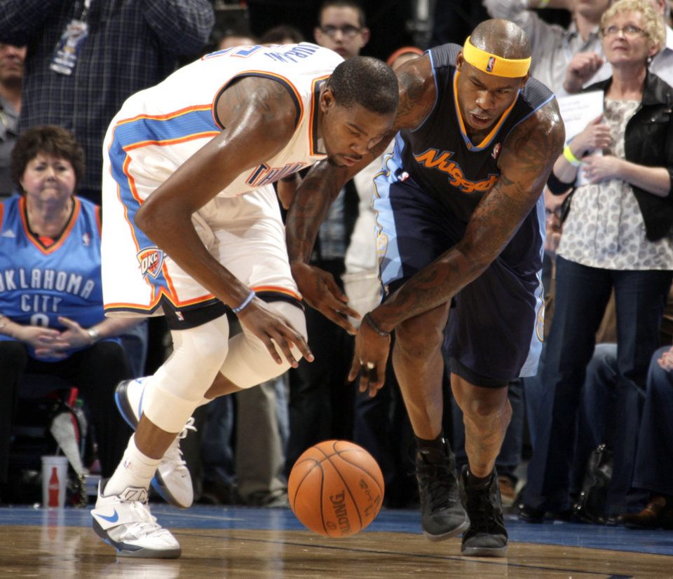 Oklahoma City's Kevin Durant (35) steals the ball from Denver's Al Harrington (7) in the final minute of over time during the NBA basketball game between the Oklahoma City Thunder and the Denver Nuggets at the Chesapeake Energy Arena, Sunday, Feb. 19, 2012. Photo by Sarah Phipps, The Oklahoman