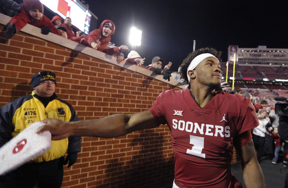Photo - Oklahoma's Kyler Murray (1) throws his towel to fans following a Bedlam college football game between the University of Oklahoma Sooners (OU) and the Oklahoma State University Cowboys (OSU) at Gaylord Family-Oklahoma Memorial Stadium in Norman, Okla., Nov. 10, 2018.  OU won 48-47. Photo by Sarah Phipps, The Oklahoman