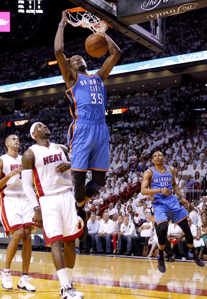 Photo - Oklahoma City's Kevin Durant (35) dunks the ball in front of Miami's LeBron James (6) during Game 4 of the NBA Finals between the Oklahoma City Thunder and the Miami Heat at American Airlines Arena, Tuesday, June 19, 2012. Photo by Bryan Terry, The Oklahoman