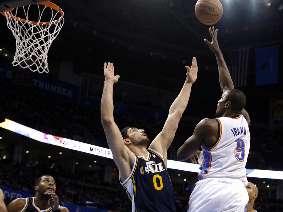 Oklahoma City \'s Serge Ibaka (9) shoots over Utah\'s Enes Kanter (0) during the NBA game between the Oklahoma City Thunder and the Utah Jazz at the Chesapeake Energy Arena, Sunday, March 30, 2014, in Oklahoma City. Photo by Sarah Phipps, The Oklahoman