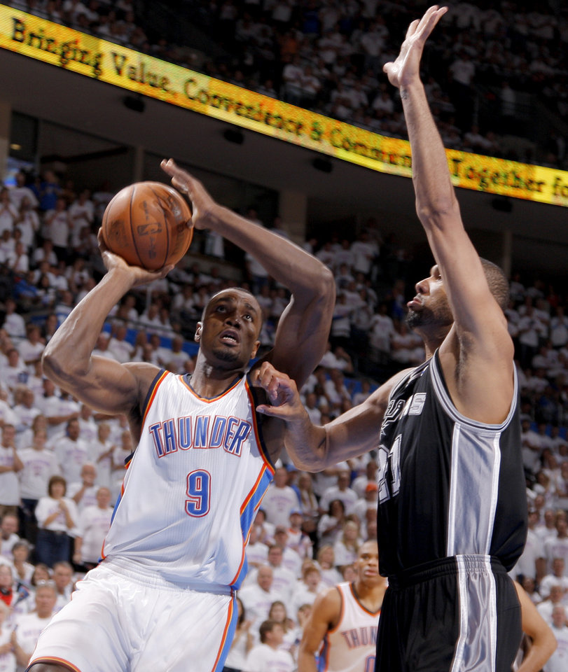 Oklahoma City's Serge Ibaka (9) goes to the basket beside San Antonio's Tim Duncan (21) during Game 6 of the Western Conference Finals between the Oklahoma City Thunder and the San Antonio Spurs in the NBA playoffs at the Chesapeake Energy Arena in Oklahoma City, Wednesday, June 6, 2012. Oklahoma City won 107-99. Photo by Bryan Terry, The Oklahoman