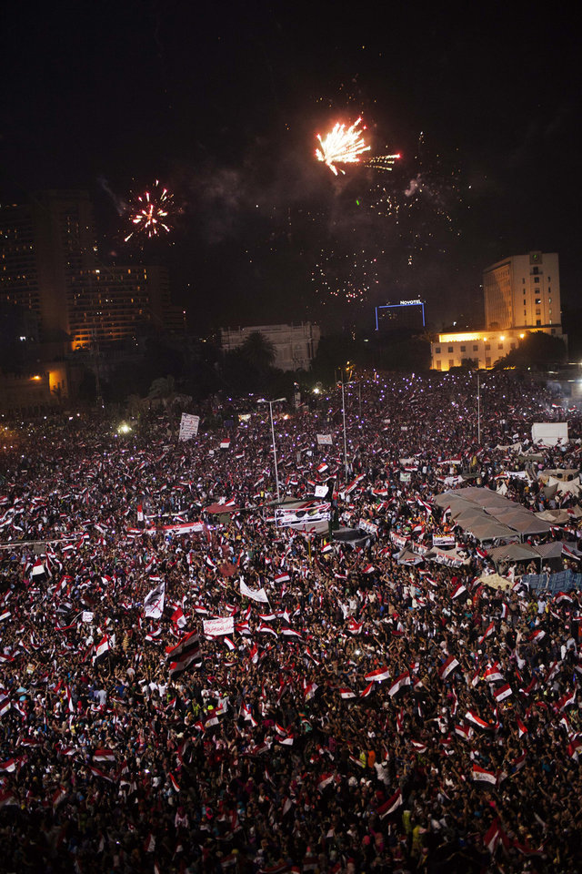 Egyptian protesters celebrate the end of Mohammed Morsi\'s presidency in Tahrir Square in Cairo, wednesday, July 3, 2013. A statement on the Egyptian president\'s office\'s Twitter account has quoted Mohammed Morsi as calling military measures