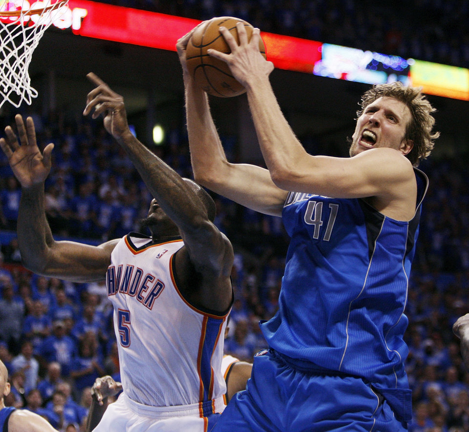 Dallas\' Dirk Nowitzki (41) grabs a rebound next to Oklahoma City\'s Kendrick Perkins (5) late in the fourth quarter during game one of the first round in the NBA playoffs between the Oklahoma City Thunder and the Dallas Mavericks at Chesapeake Energy Arena in Oklahoma City, Saturday, April 28, 2012. Oklahoma City won, 99-98. Photo by Nate Billings, The Oklahoman
