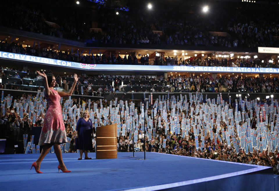 Photo - First Lady Michelle Obama waves to delegates at the Democratic National Convention in Charlotte, N.C., on Monday, Sept. 3, 2012. (AP Photo/Jae C. Hong)  ORG XMIT: DNC797
