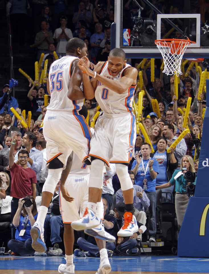 Photo - REACTION: Oklahoma City Thunder small forward Kevin Durant (35) and Oklahoma City Thunder point guard Russell Westbrook (0) react after Westbrook's three-pointer to seal the 115-104 win over Phonenix during the NBA basketball game between the Oklahoma City Thunder and the Phoenix Suns at the Chesapeake Energy Arena on Wednesday, March 7, 2012 in Oklahoma City, Okla.  Photo by Chris Landsberger, The Oklahoman
