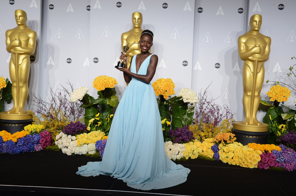 Photo - Lupita Nyong'o poses in the press room with the award for best actress in a supporting role for