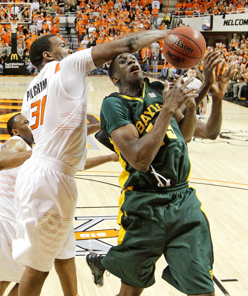 Photo - OSU's Matt Pilgrim blocks the shot of Baylor's Ekpe Udoh during an NCAA college basketball game between Oklahoma State University and Baylor at Gallagher-Iba Arena in Stillwater, Okla., Saturday, Feb. 20, 2010.  Photo by Bryan Terry, The Oklahoman ORG XMIT: KOD