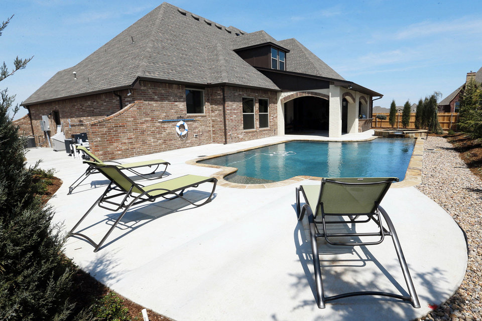 Pool-area hookups allow for cool-weather swimming or outdoor parties warmed by portable natural gas heaters at the Landmark model home. Photos by Steve Sisney, The Oklahoman