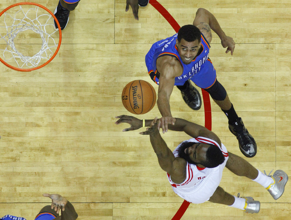Oklahoma City\'s Thabo Sefolosha (2) defends Houston\'s James Harden (13) during Game 6 in the first round of the NBA playoffs between the Oklahoma City Thunder and the Houston Rockets at the Toyota Center in Houston, Texas, Friday, May 3, 2013. Oklahoma City won 103-94. Photo by Bryan Terry, The Oklahoman