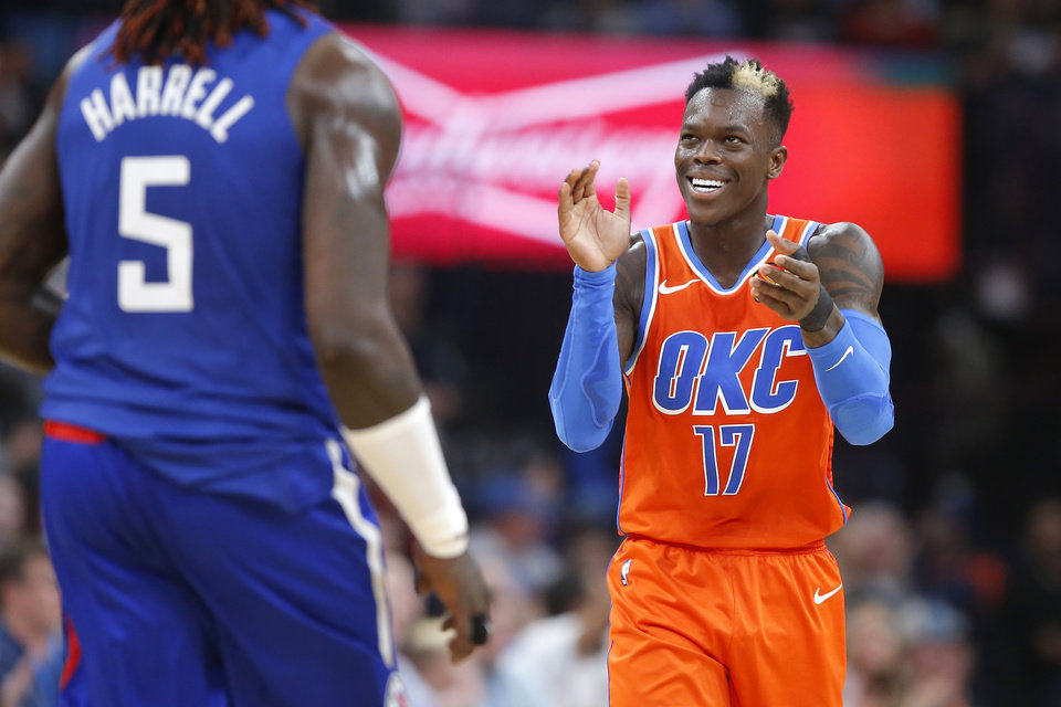 Photo - Oklahoma City's Dennis Schroder (17) claps after a Thunder basket during an NBA basketball game between the Oklahoma City Thunder and the LA Clippers at Chesapeake Energy Arena in Oklahoma City, Sunday, Dec. 22, 2019. Oklahoma City won 118-112. [Bryan Terry/The Oklahoman]
