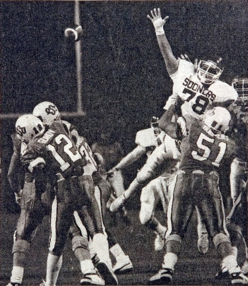 Photo - OSU's Mike Gundy unleashes a fourth-down pass to Brent Parker with less than a minute to go in the fourth quarter Saturday, Nov. 5, 1988 during the Bedlam college football game between the Oklahoma Sooners and Oklahoma State Cowboys. Staff Photo by David McDaniel