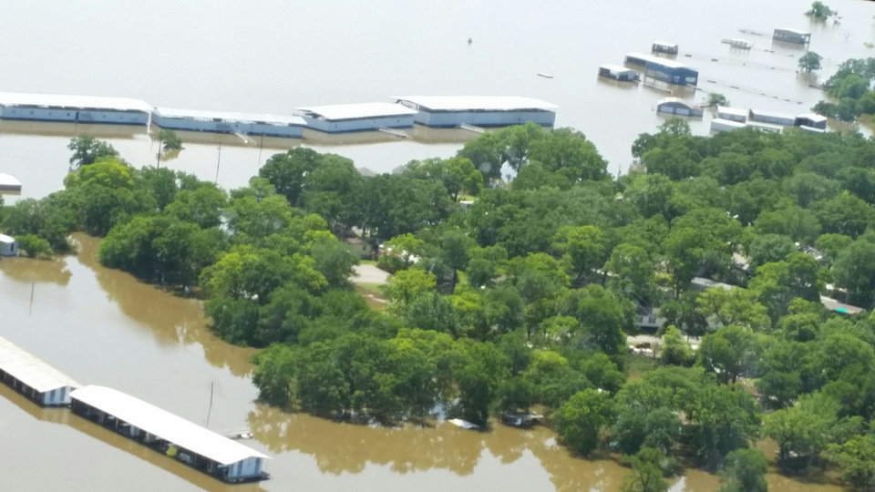 Photo - The rising water level at Lake Texoma has caused flooding at a marina and surrounding areas.