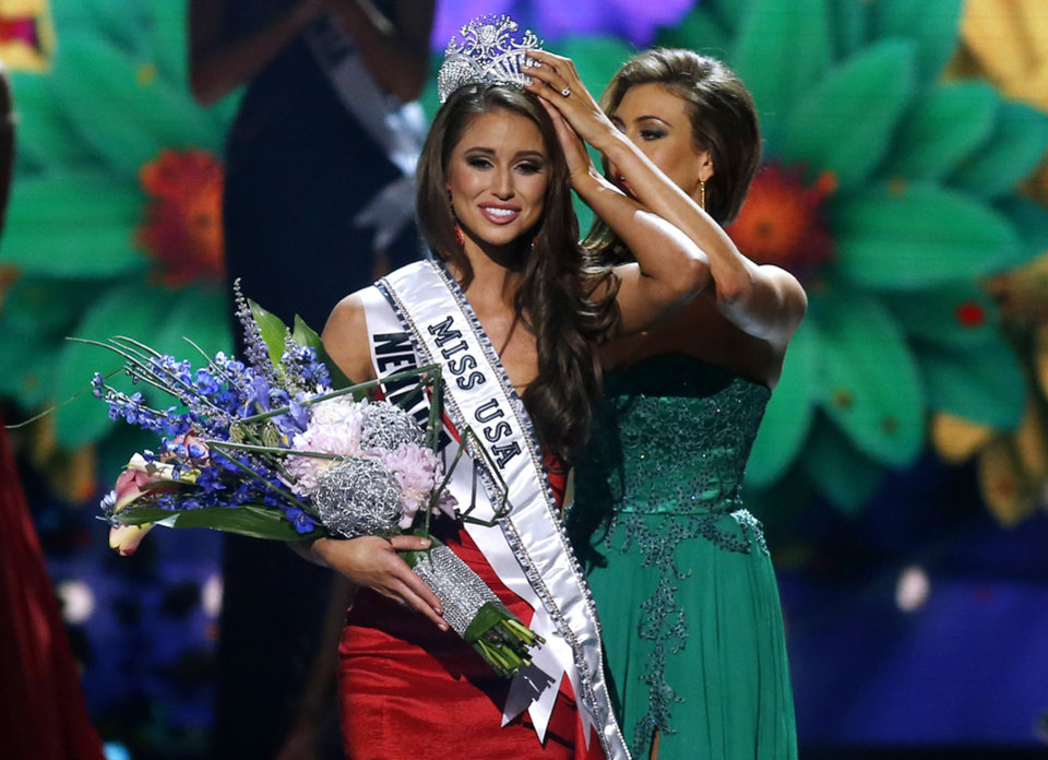 Photo - Miss Nevada USA Nia Sanchez is crowned Miss USA during the Miss USA 2014 pageant in Baton Rouge, La., Sunday, June 8, 2014. (AP Photo/Jonathan Bachman)