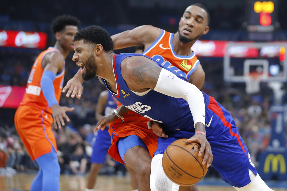 Photo - Oklahoma City's Terrance Ferguson (23) defends LA's Paul George (13) during an NBA basketball game between the Oklahoma City Thunder and the LA Clippers at Chesapeake Energy Arena in Oklahoma City, Sunday, Dec. 22, 2019. Oklahoma City won 118-112. [Bryan Terry/The Oklahoman]