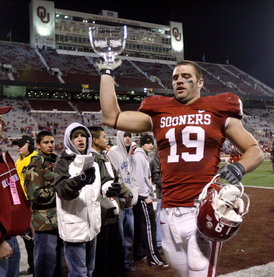 Photo - Joe Jon Finley  leaves Owen Field after the 2007 Bedlam game. Finley was named the Sooners' assistant head coach for offense on Tuesday, taking over the role vacated when Shane Beamer accepted the head coaching job at South Carolina in December. [Photo By Bryan Terry/The Oklahoman]