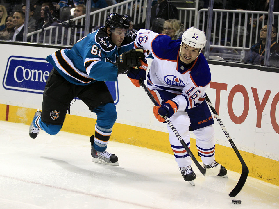 Edmonton Oilers left wing Darcy Hordichuk (16) is defended by San Jose Sharks' Justin Braun during the second period of an NHL hockey game in San Jose, Calif., Saturday, Dec. 17, 2011. (AP Photo/Marcio Jose Sanchez)