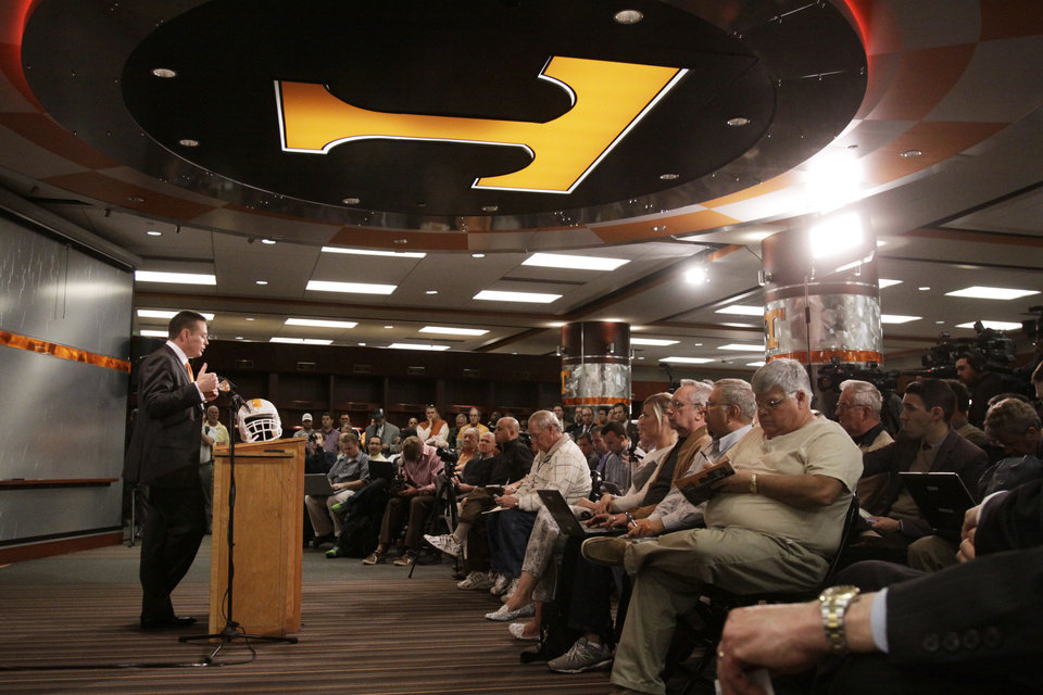 Photo - Butch Jones answers questions during a news conference Friday, Dec. 7, 2012, in Knoxville, Tenn., as he was introduced as Tennessee football coach. (AP Photo/Chattanooga Times Free Press, Patrick Smith) MANDATORY CREDIT  NOOGA.COM OUT  CLEVELAND DAILY BANNER OUT  DALTON OUT