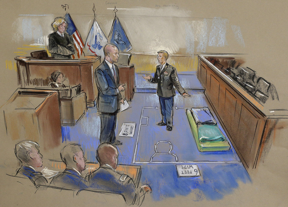 Photo - In this courtroom sketch, Army Pfc. Bradley Manning, center, describes a layout of his pretrial confinement cell in a Quantico, Va., Marine Corps brig while testifying at a pretrial hearing in Fort Meade, Md. on Thursday, Nov. 29, 2012. Military Judge, Col. Denise Lind, is at top left, and Manning's defense attorney David Coombs, is at second from left. (AP Photo/William Hennessy) NO TV, NO ARCHIVE, NO SALES, LOCALS OUT