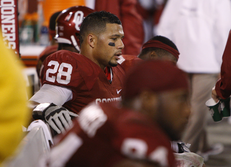 Oklahoma\'s Travis Lewis (28) sits on the bench during the college football game between the University of Oklahoma Sooners (OU) and the Texas Tech University Red Raiders (TTU) at Gaylord Family-Oklahoma Memorial Stadium in Norman, Okla., Sunday, Oct. 23, 2011. Oklahoma lost 38-41. Photo by Bryan Terry, The Oklahoman