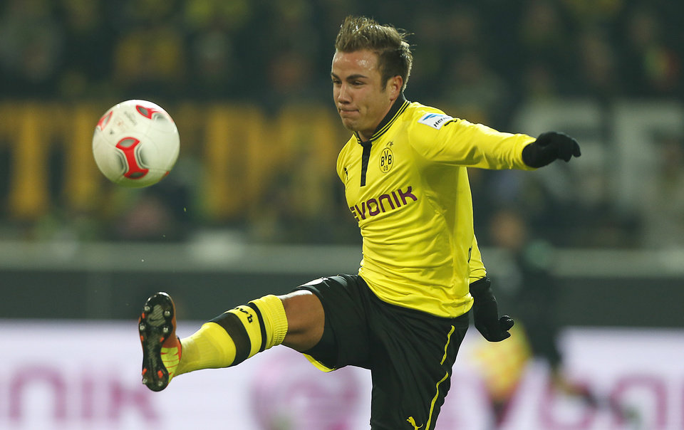 Photo - FILE - In this Jan. 25, 2013 file photo Dortmund's Mario Goetze challenges for the ball during the German first division Bundesliga soccer match between  BvB Borussia Dortmund  and 1.FC Nuremberg in Dortmund, Germany. German daily Bild says Goetze has agreed to join Bayern Munich from Bundesliga rival Borussia Dortmund. Bild reports Tuesday, April 23, 2013, that Bayern will pay the 20-year-old Goetze's buy-out clause of around 37 million euros (US dollar 48 million) to sign the Germany star at the end of the season. (AP Photo/Frank Augstein, File)