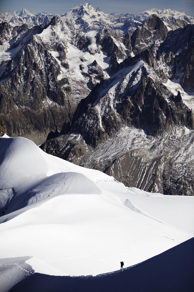 Photo - File - In this Wednesday, Oct. 12, 2011 file photo, an alpinist walks down a ridge on the Aiguille du Midi (3,842 meters; 12 605 feet), towards the Vallee Blanche on the Mont Blanc massif, in the Alps, near Chamonix, France.  A mayor in the French Alps says five climbers have died on Mont Blanc and a sixth is missing. The climbers disappeared overnight as they were trying to reach the Aiguille d'Argentiere, which tops out around 3,900 meters (12,800 feet). Mont Blanc, in addition to its primary peak, contains some 200 summits. The bodies of five climbers were located Wednesday, Aug. 13, 2014, while a sixth has not been found, said Jean-Marc Peillex, mayor of Saint-Gervais, a town at the foot of Europe's tallest mountain. (AP Photo/David Azia, File)