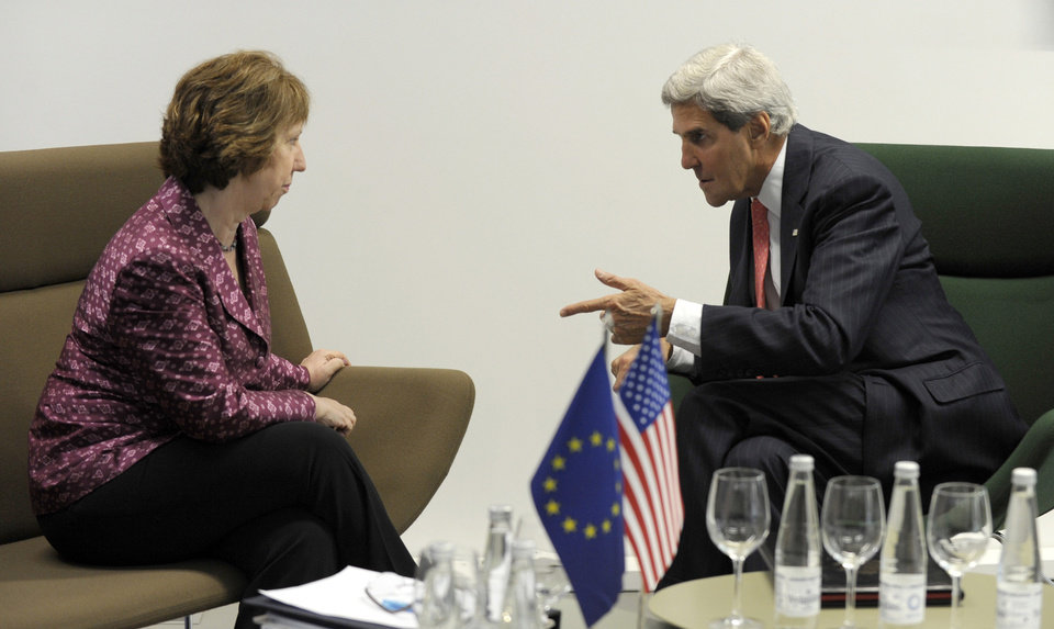 Photo - U.S. Secretary of State John Kerry meets with European Union High Representative Catherine Ashton before the Meeting of EU Ministers of Foreign Affairs at the National Gallery of Art in Vilnius, Lithuania, Saturday, Sept. 7, 2013. Kerry traveled to Europe to court international support for a possible strike on the Syrian regime for its alleged use of chemical weapons while making calls back home to lobby Congress where the action faces an uphill battle. (AP Photo/Susan Walsh, Pool)