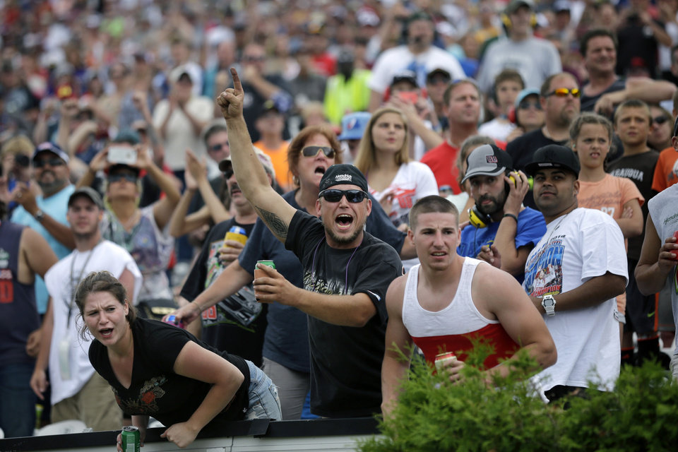 Photo - Fans cheer as Dale Earnhardt Jr. leads late in the NASCAR Sprint Cup Series auto race at Pocono Raceway, Sunday, Aug. 3, 2014, Long Pond, Pa. Earnhardt  won the race. (AP Photo/Mel Evans)